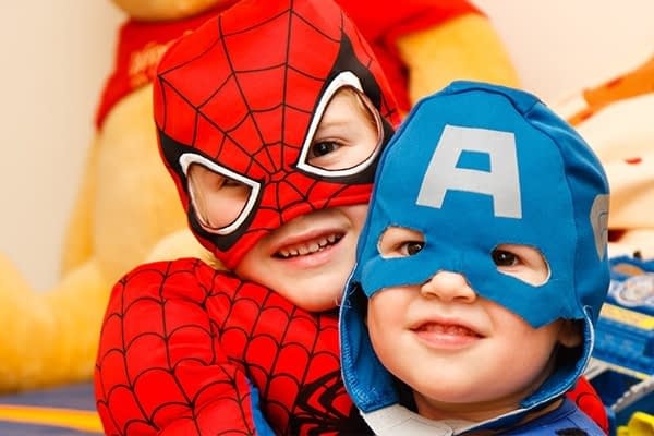 JC Pro - two brothers taking their family photo dressed in a spiderman and captain America costumes